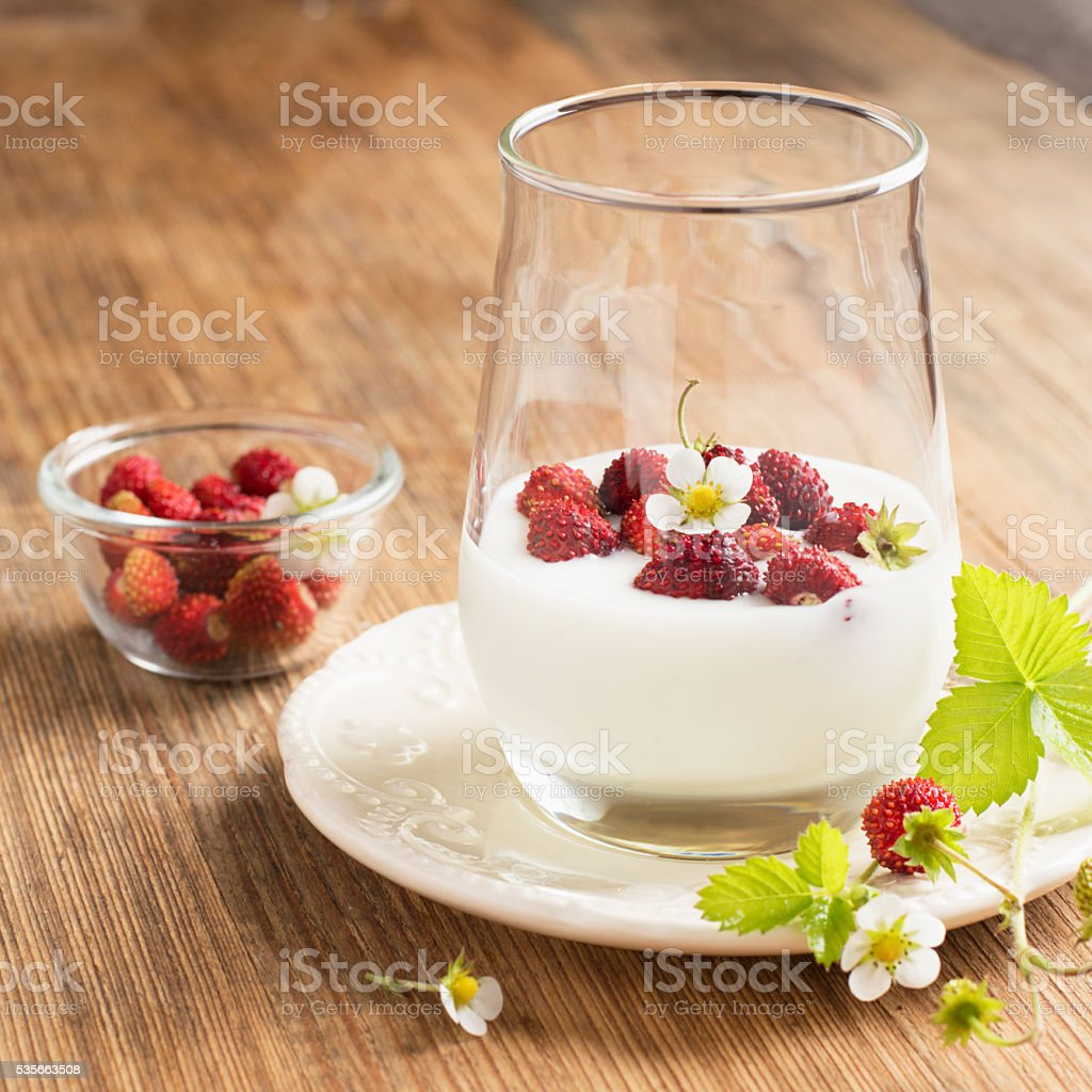 Natural yogurt with fresh strawberries for breakfast stock photo