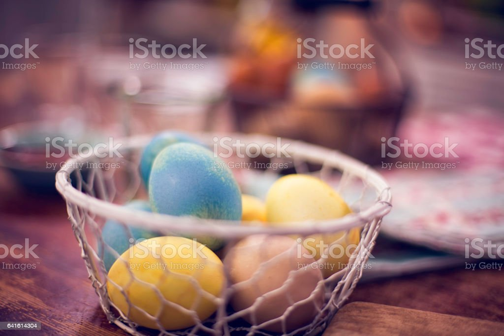 Naturally Dyed Easter Eggs in a Basket stock photo