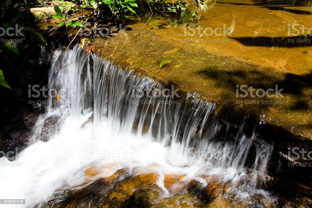 Nature. A small tropical waterfall with clear water. stock photo
