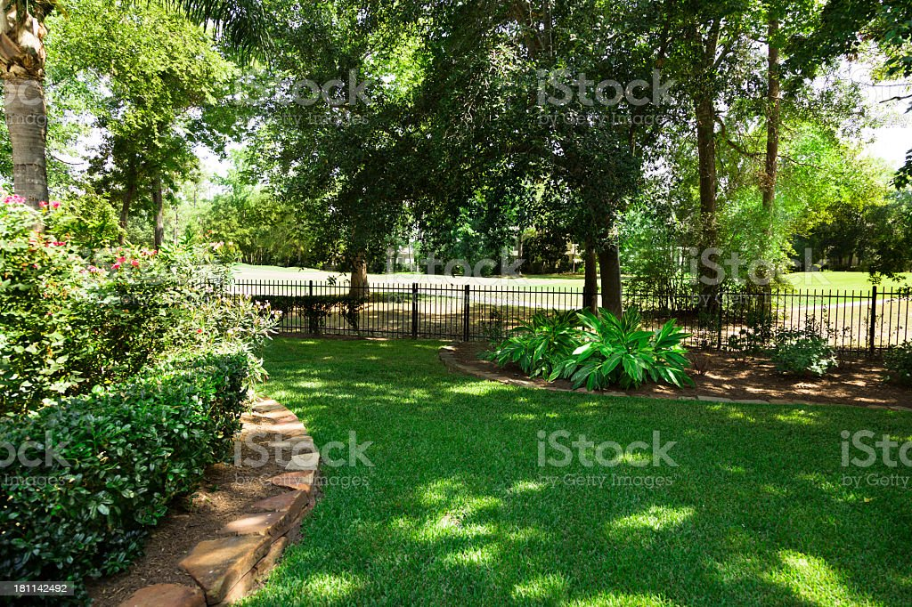 Nature:  Backyard overlooking golf course.  Flowerbeds and shrub stock photo
