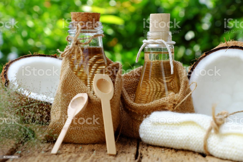Nature cosmetic products, coconut oil from copra in glass jar on...