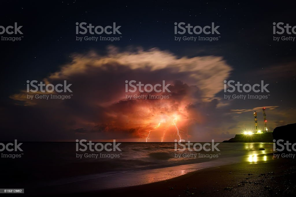 Nature force background - lightning in dark sky, sea stock photo