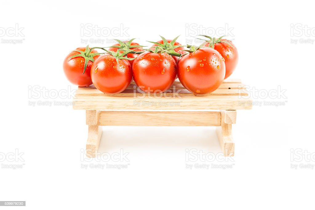 nature fresh tomatoes with green vine on  wooden stock photo
