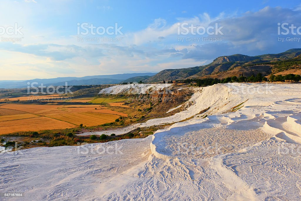 Nature landmarks in Turkey - landscape with travertines and fiel stock photo