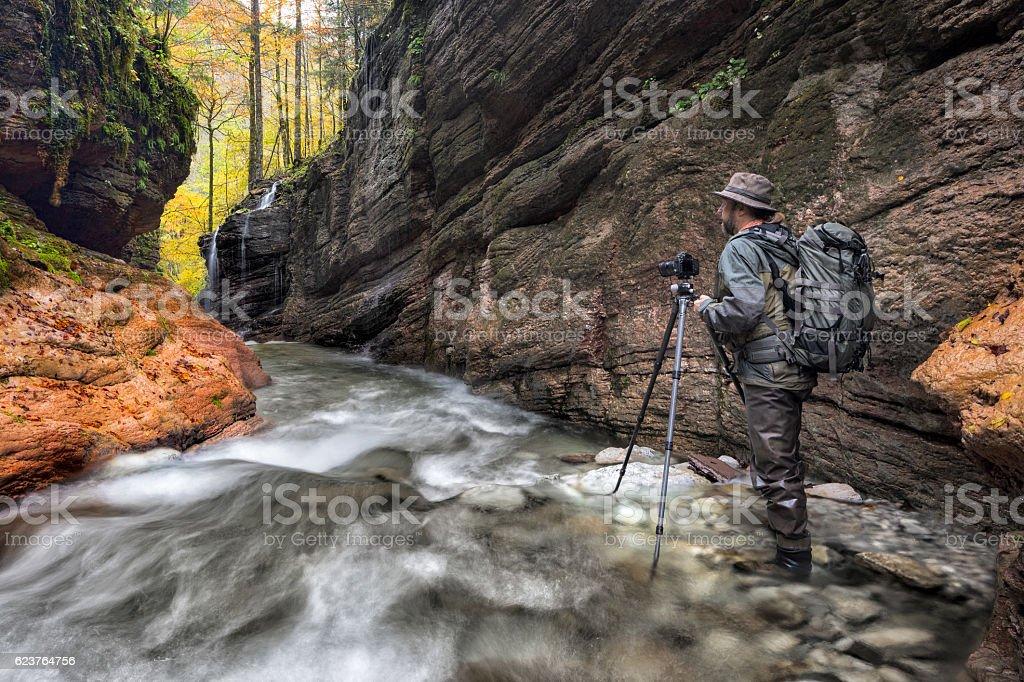 Nature photographer at alpine Stream - Taugl canyon stock photo