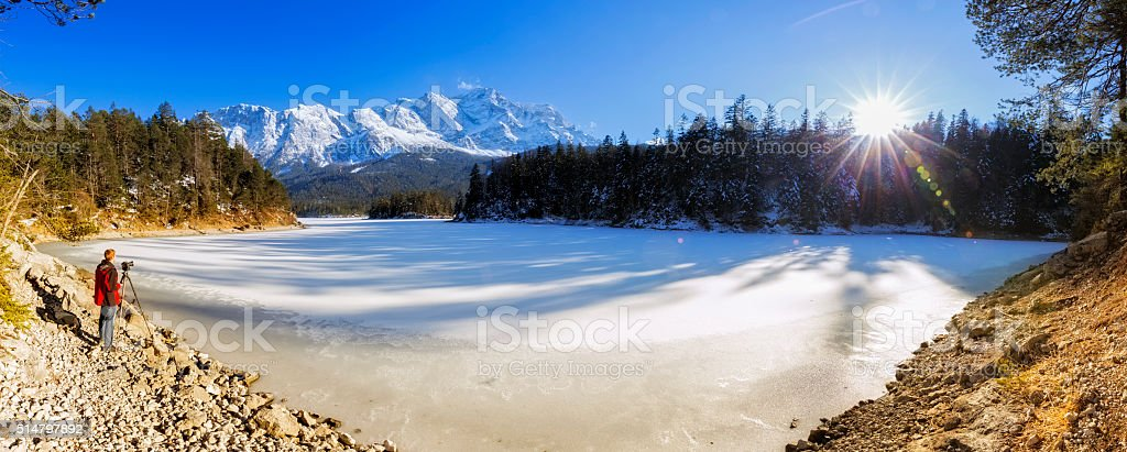 Nature photographer at lake Eibsee near Garmisch Partenkirchen stock photo