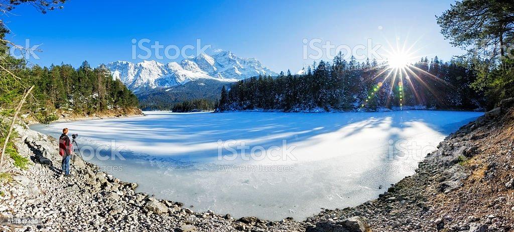 Nature photographer at lake Eibsee near Garmisch Partenkirchen stock photo