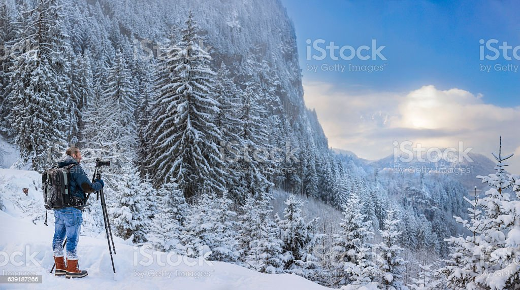 Nature photographer at winter in front of Hohenschwangau stock photo