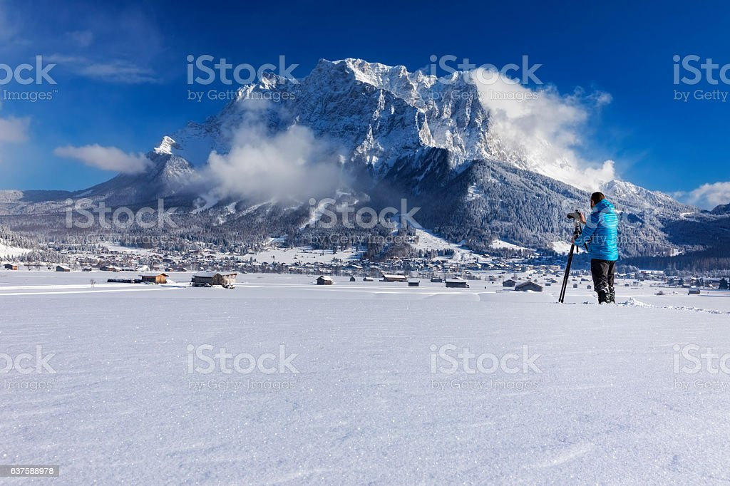 Nature photographer at winter in front of Mount Zugspitze stock photo