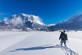 Nature photographer at winter in front of Mount Zugspitze