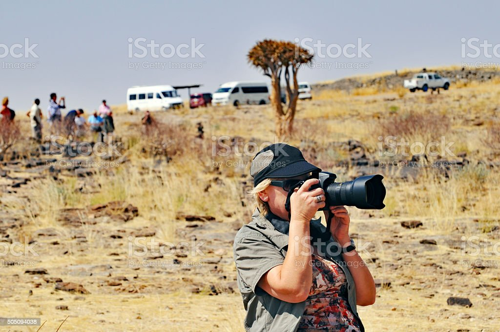 Nature photographer in action stock photo