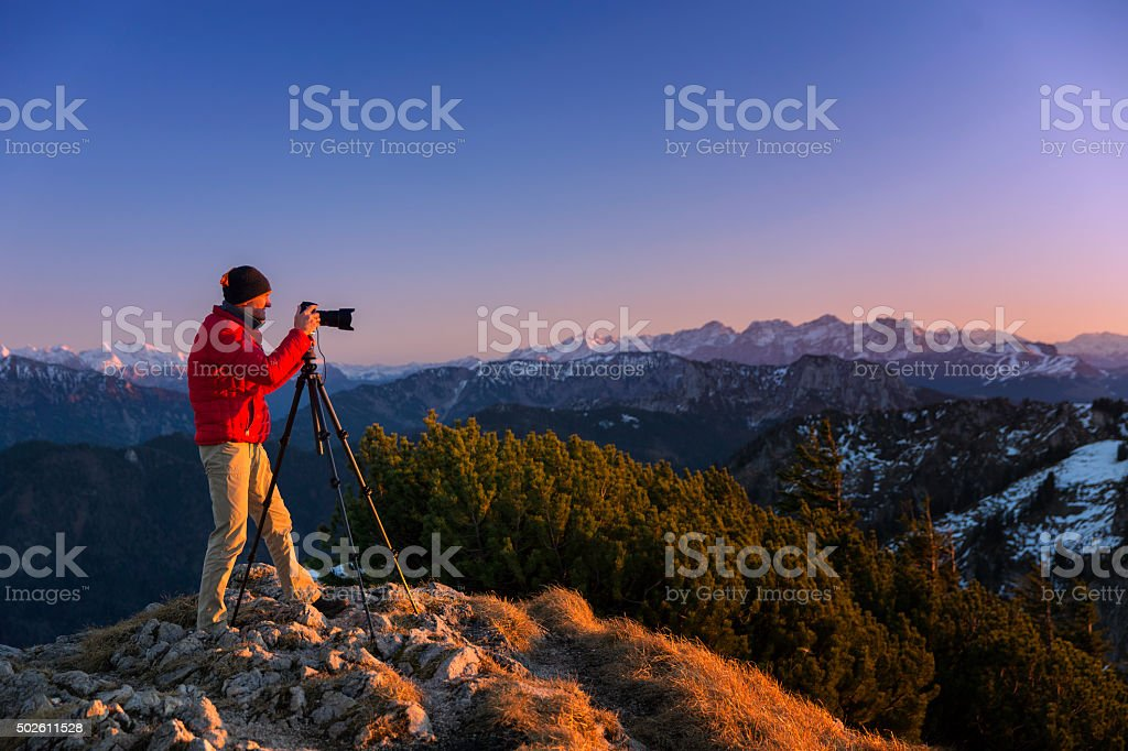 Nature photographer in the alps stock photo