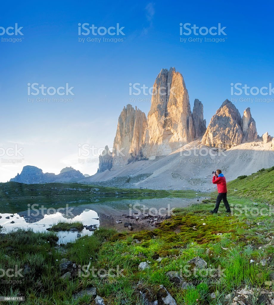 Nature photographer in the Dolomites at sunrise stock photo