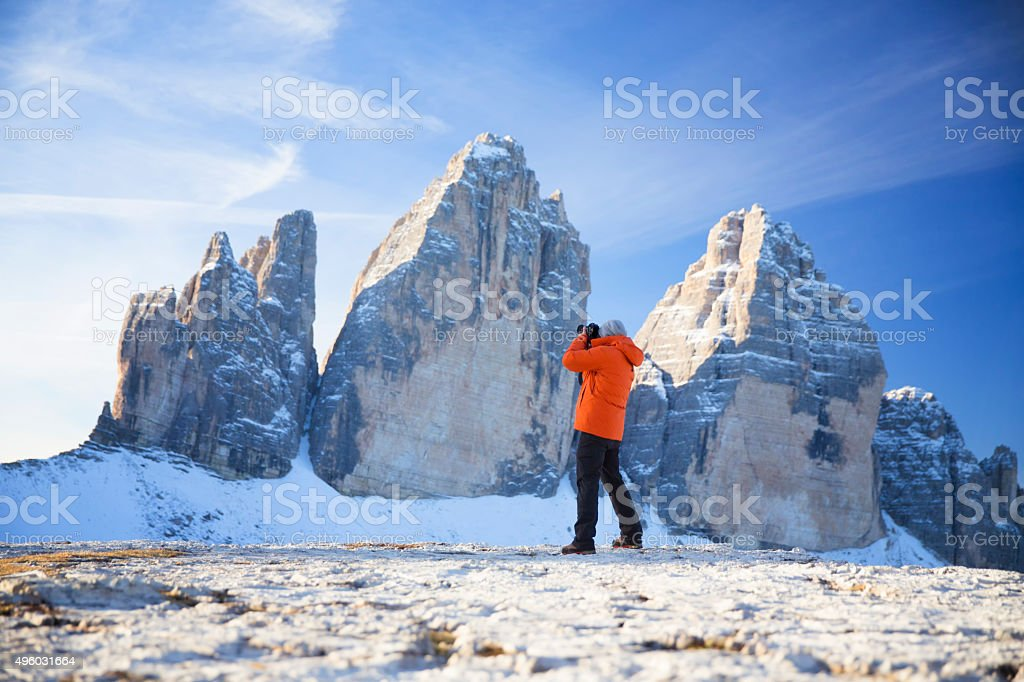Nature photographer in  the Dolomites stock photo