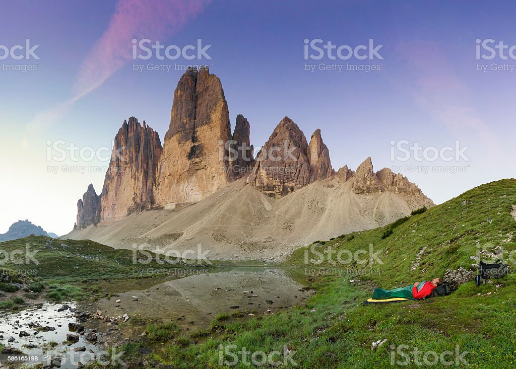 Nature photographer is sleeping at the Cime of the Dolomites stock photo