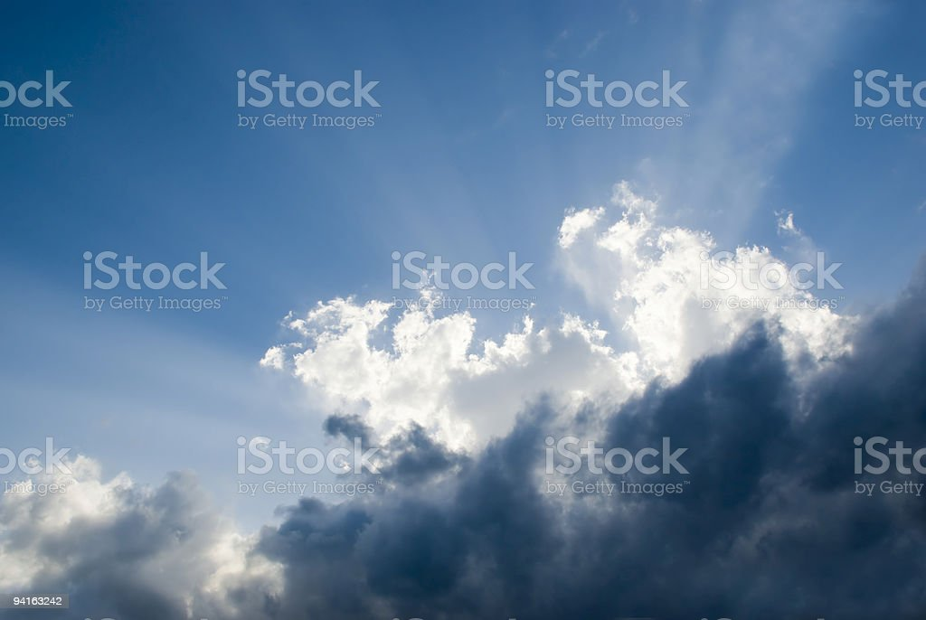 Nature Scene with Blue Sky, Puffy Clouds and Sunbeam royalty-free stock photo