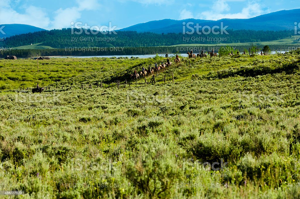 Nature: Trail Riders traveling through Montana Rocky Mountain range. royalty-free stock photo