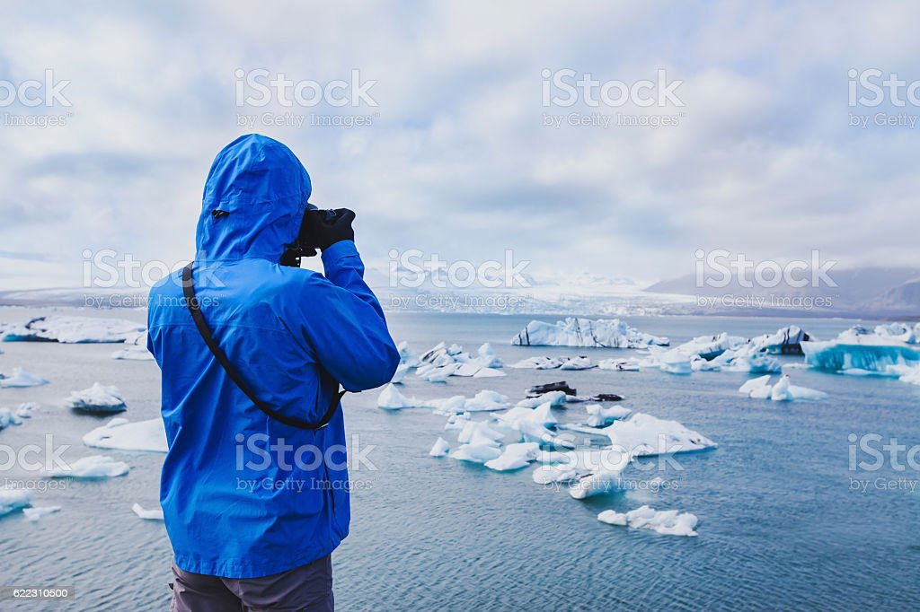 nature travel photographer taking photos in Iceland stock photo