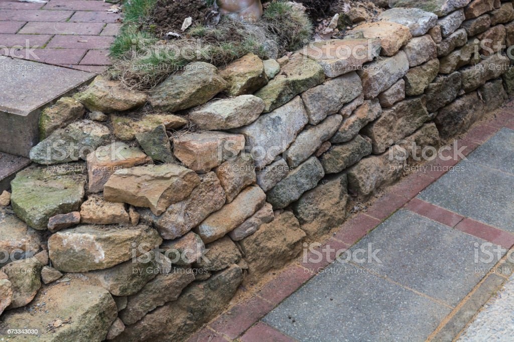 Natursteinmauer trocken verlegt stock photo