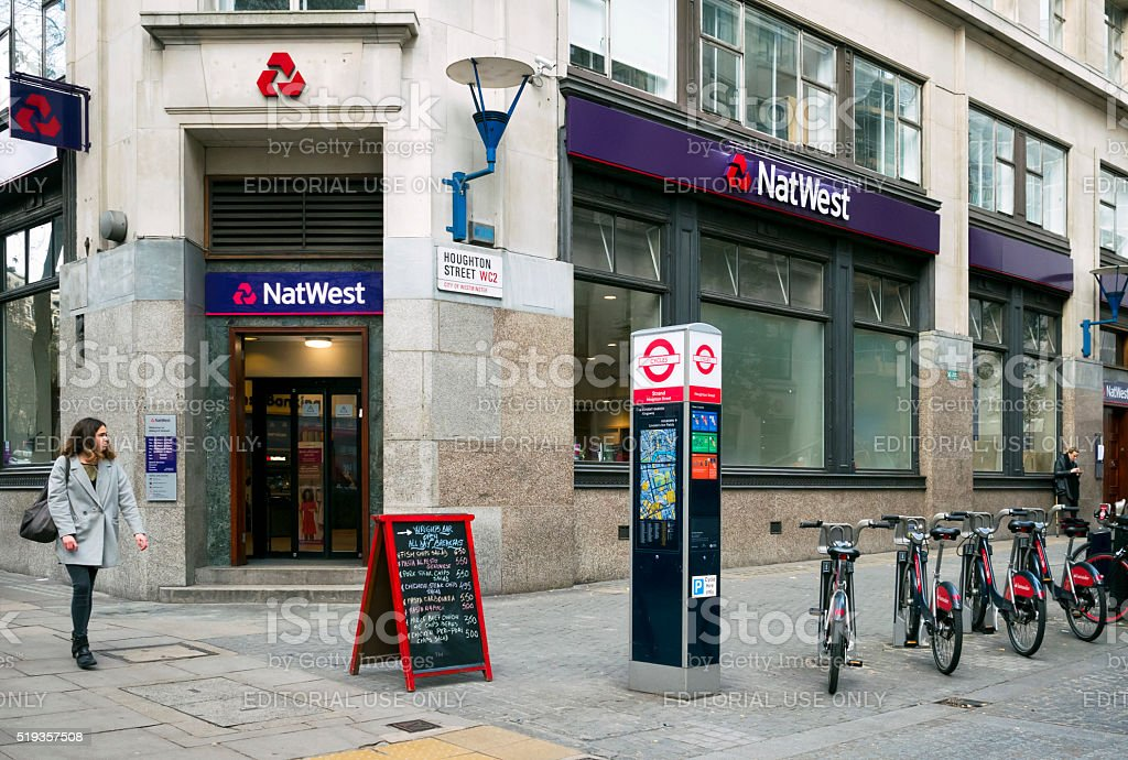 NatWest Bank and Santander bikes in Houghton Street, London stock photo