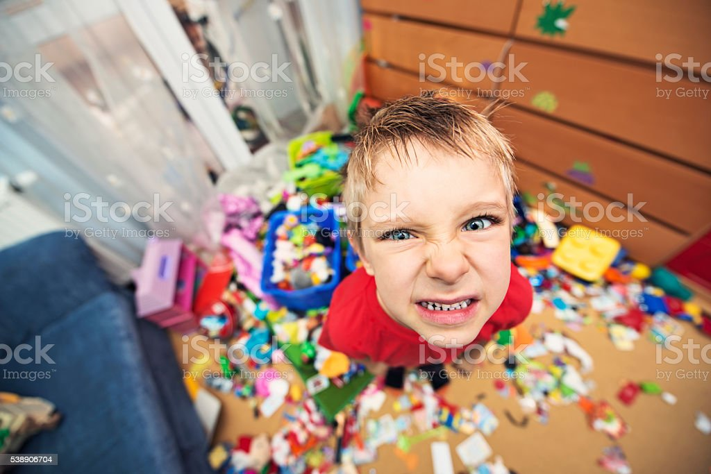 Naughty and messy little boy stock photo