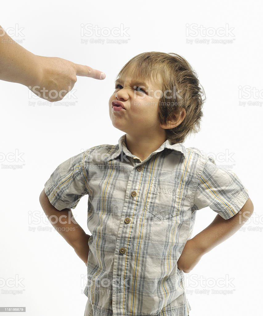 Naughty child being told off royalty-free stock photo