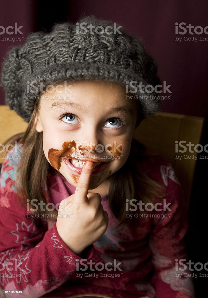 Naughty girl covered in chocolate royalty-free stock photo