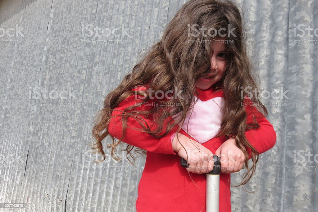 Naughty girl does trick stock photo