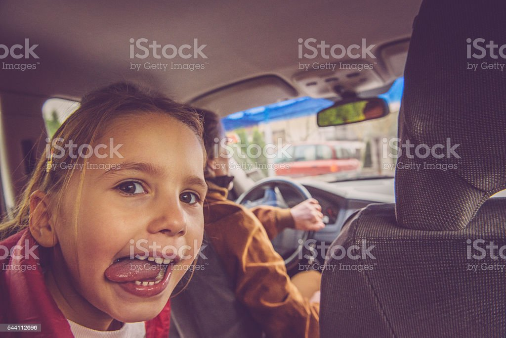 Naughty Girl of Five Passenger in Car, Europe stock photo