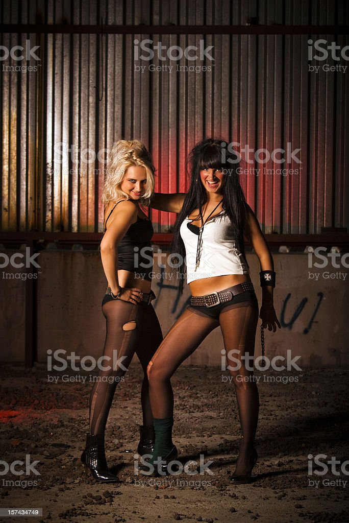 Naughty Girls in abandoned building stock photo