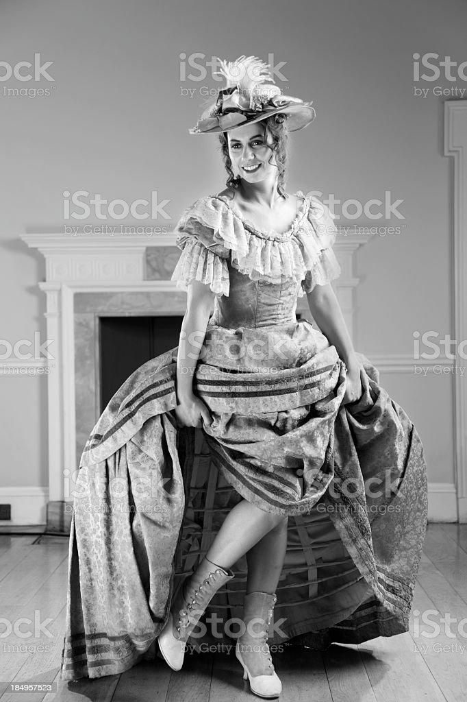naughty victorian lady lifts skirts stock photo