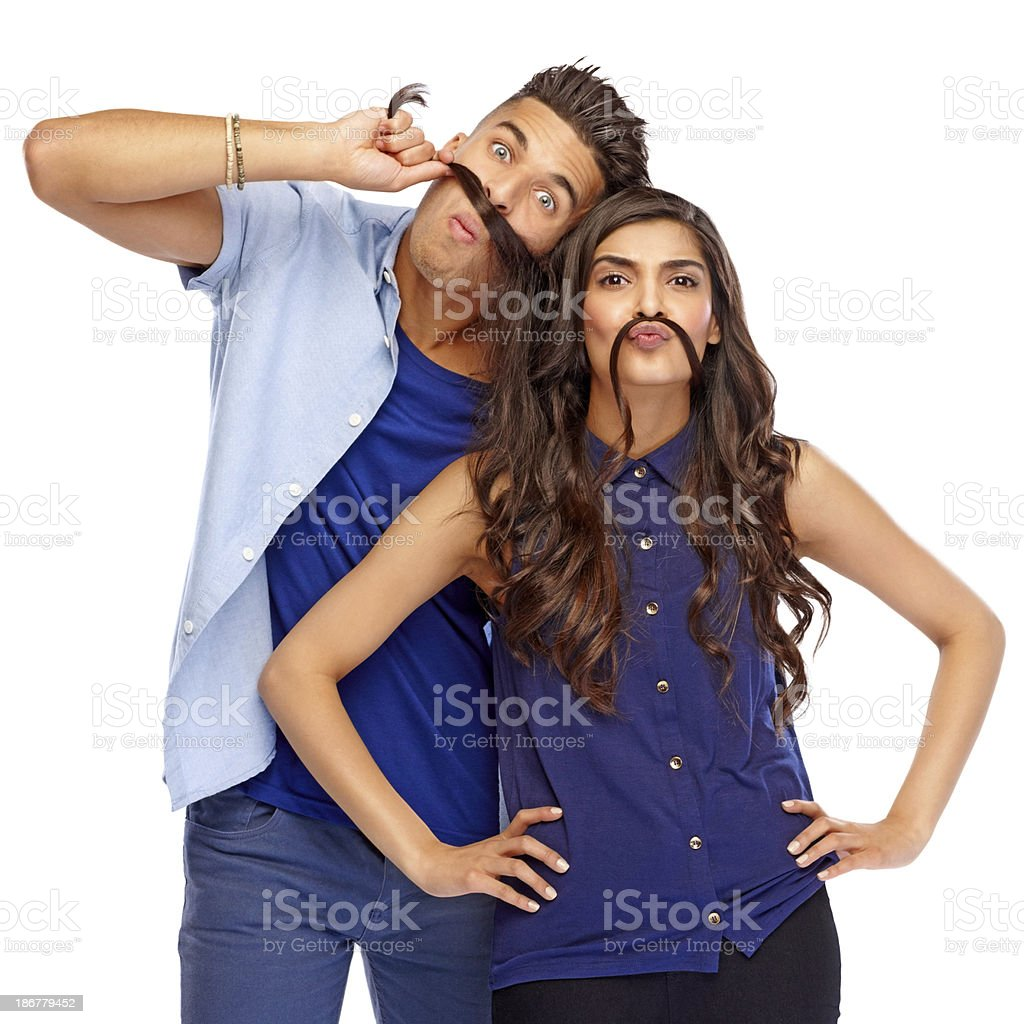 Naughty young couple making funny faces royalty-free stock photo