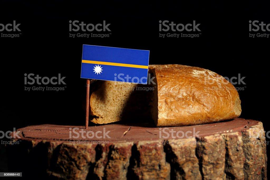 Nauru flag on a stump with bread isolated stock photo