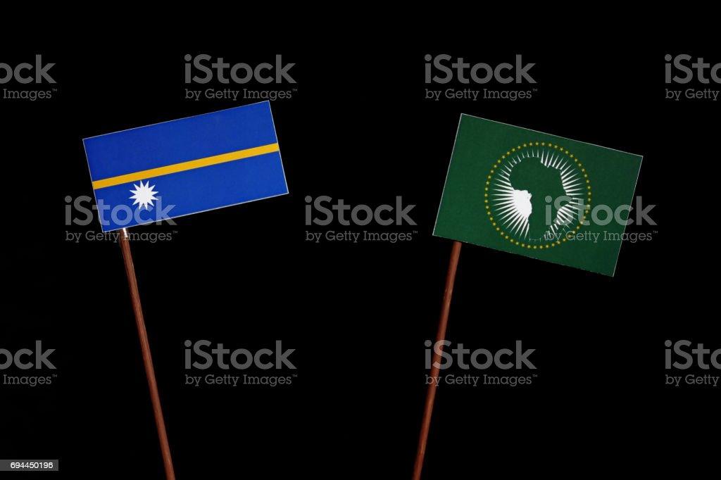 Nauru flag with African Union flag isolated on black background stock photo