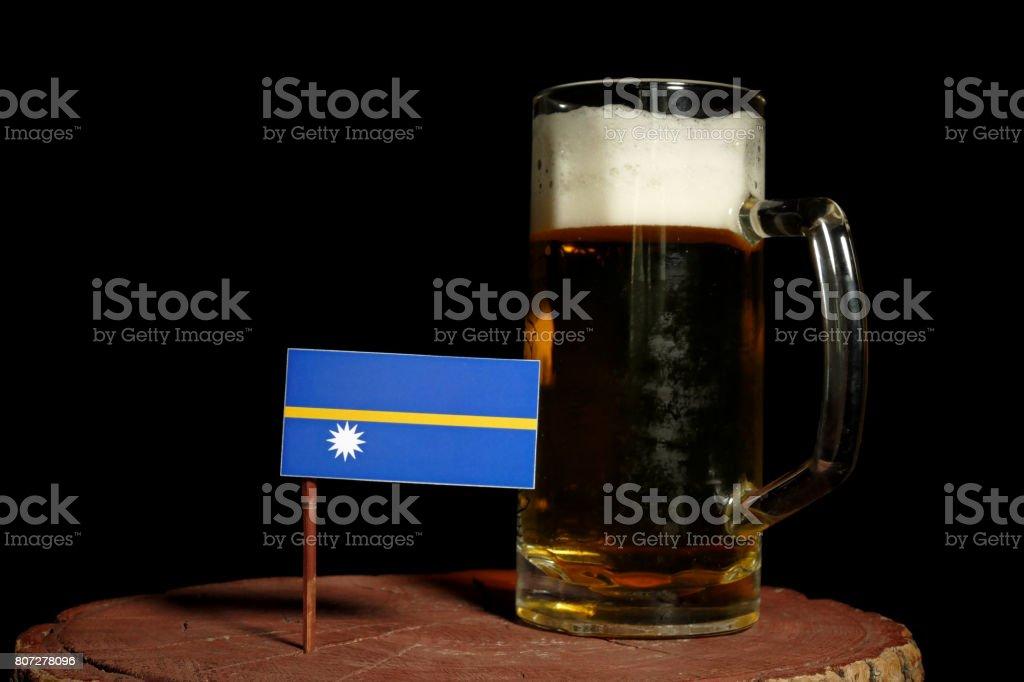 Nauru flag with beer mug isolated on black background stock photo