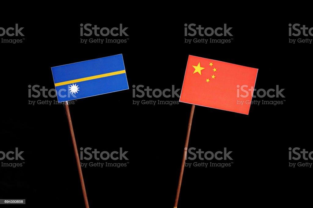Nauru flag with Chinese flag isolated on black background stock photo
