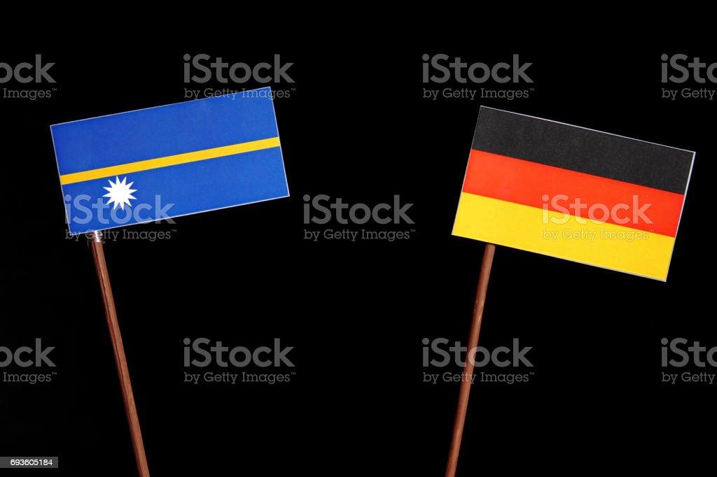Nauru flag with German flag isolated on black background stock photo