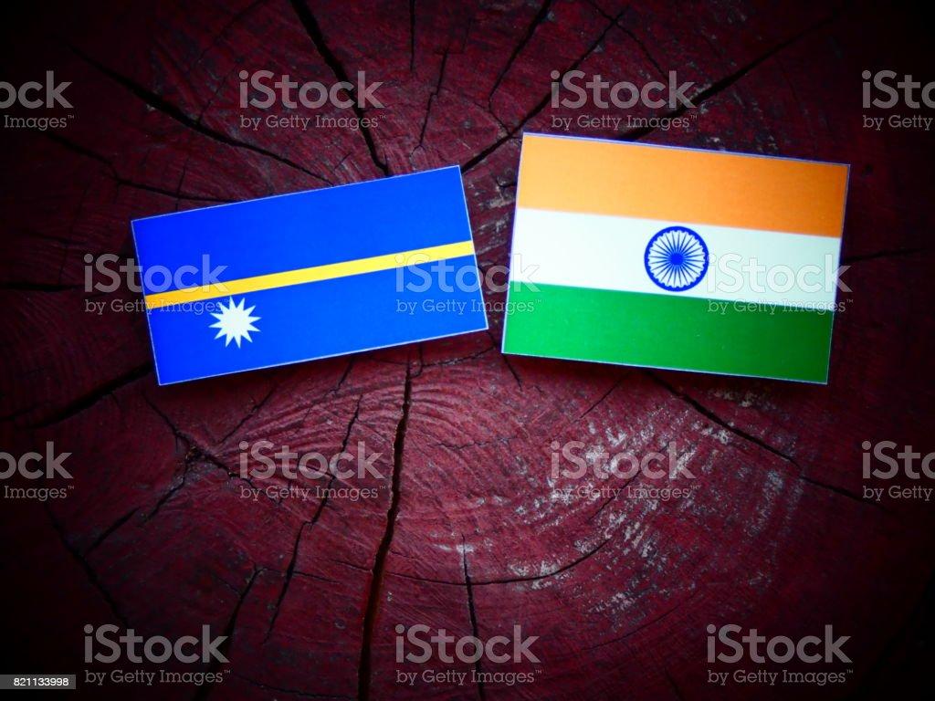 Nauru flag with Indian flag on a tree stump isolated stock photo
