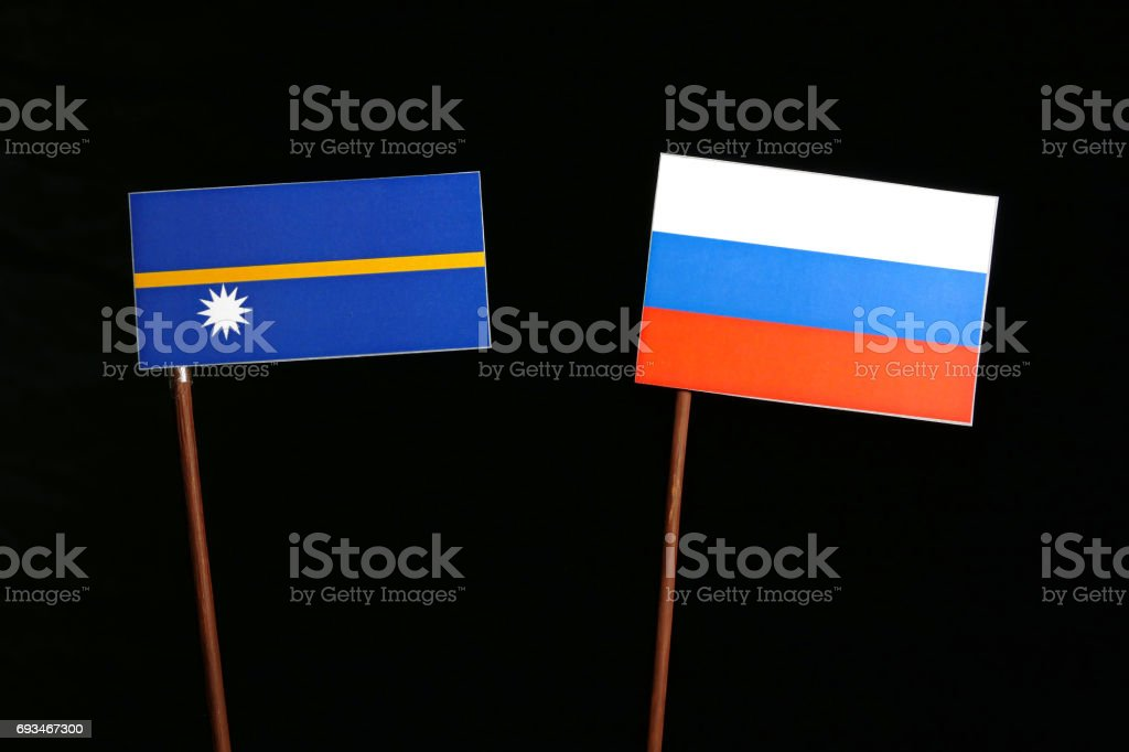 Nauru flag with Russian flag isolated on black background stock photo