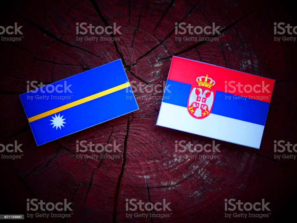Nauru flag with Serbian flag on a tree stump isolated stock photo