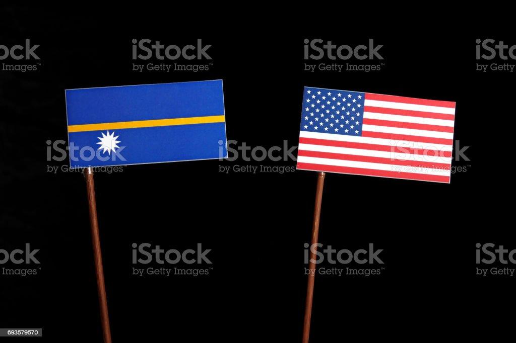 Nauru flag with USA flag isolated on black background stock photo