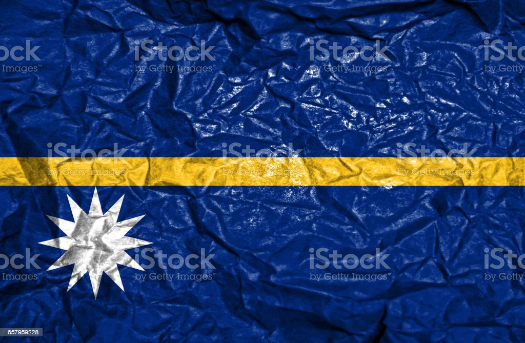 Nauru vintage flag on old crumpled paper background stock photo
