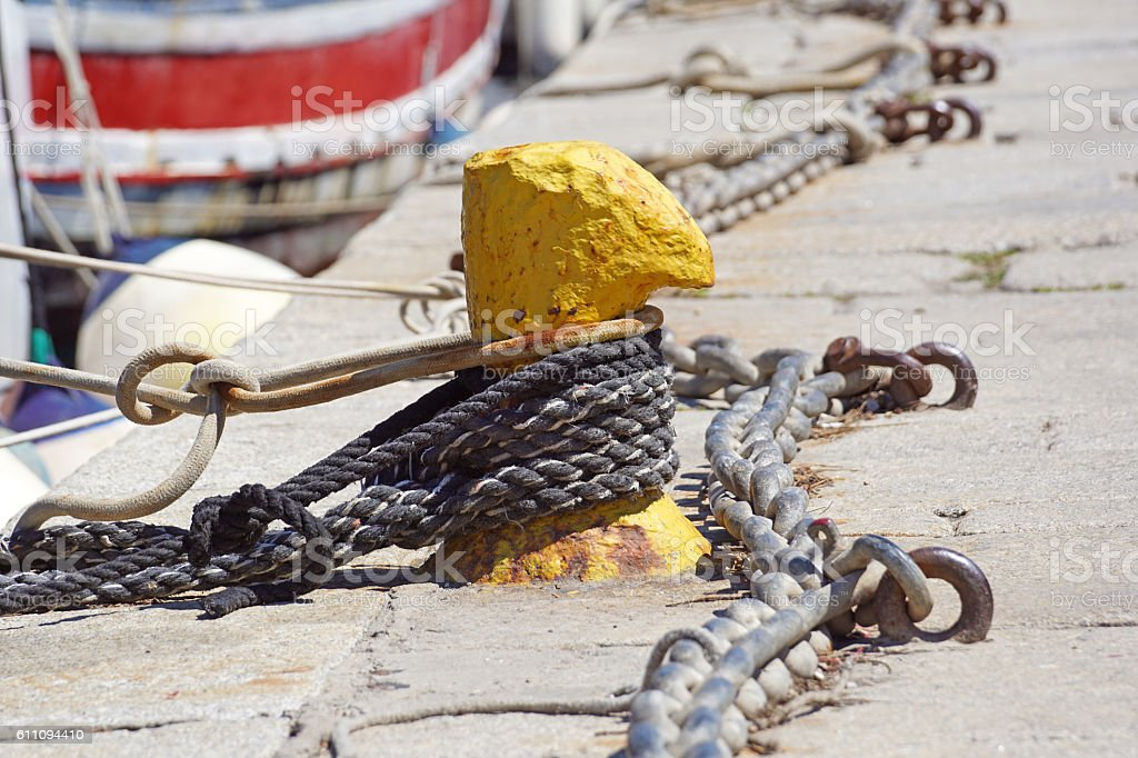 nautical anchor chains on the pier stock photo