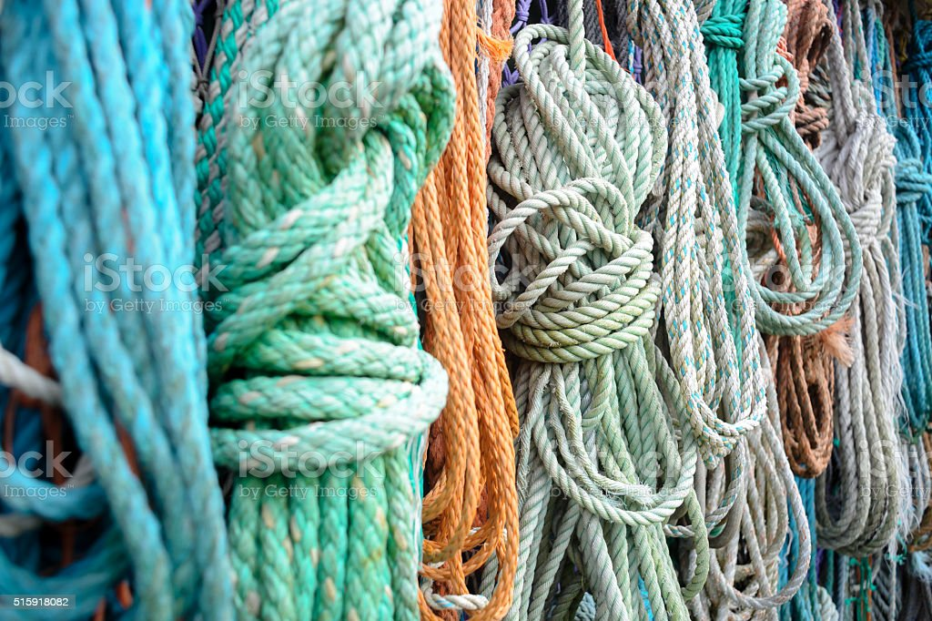 Nautical background. Closeup of old colorful mooring ropes , Old stock photo