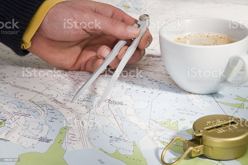 Nautical chart,magnetic compass and coffee cup stock photo