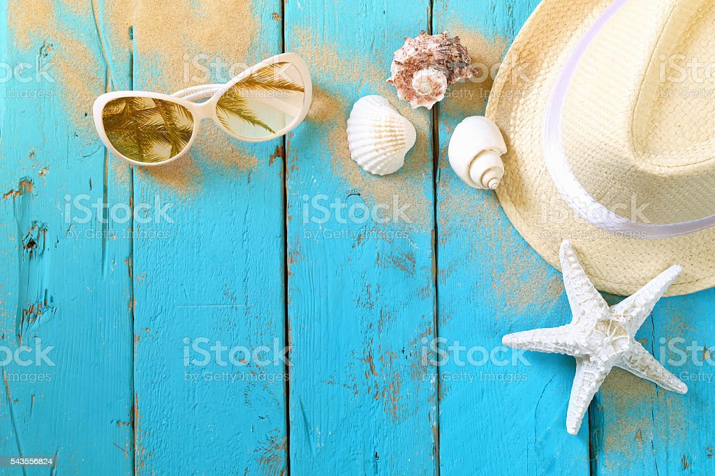 nautical concept with fedora hat, sunglasses and seashells stock photo