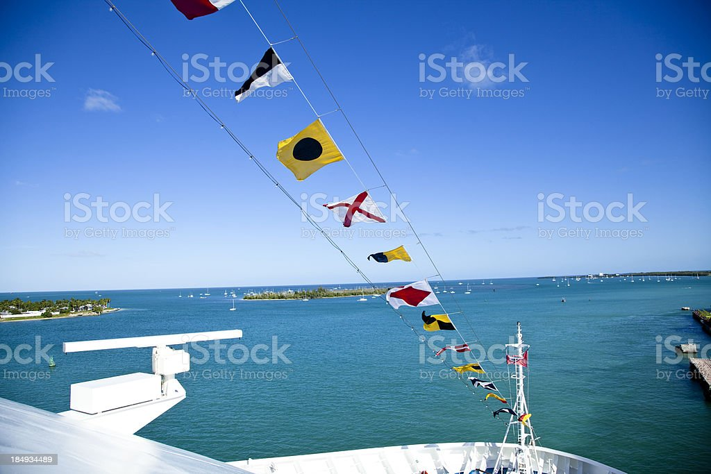 Nautical flags on the bow of a docked cruise ship royalty-free stock photo
