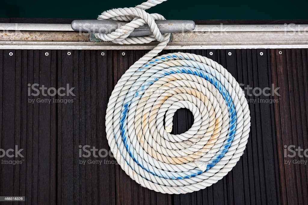 A nautical mooring rope swirled around itself stock photo