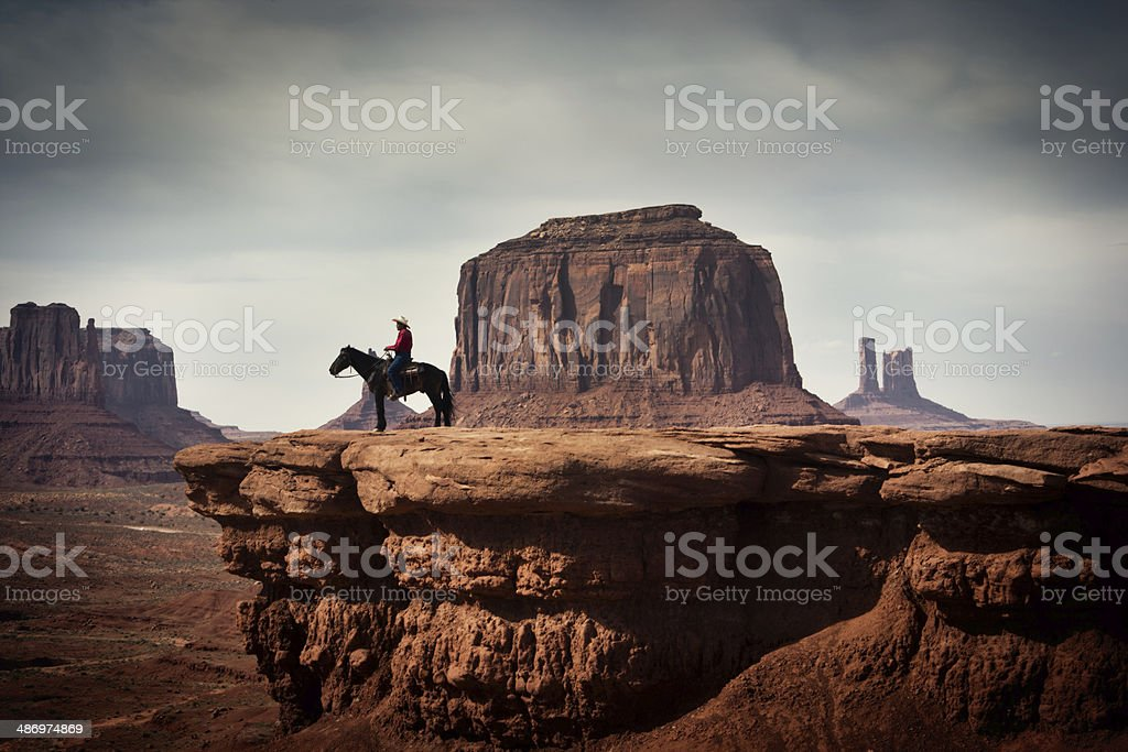 Navajo Cowboy in American Southwest Landscape stock photo