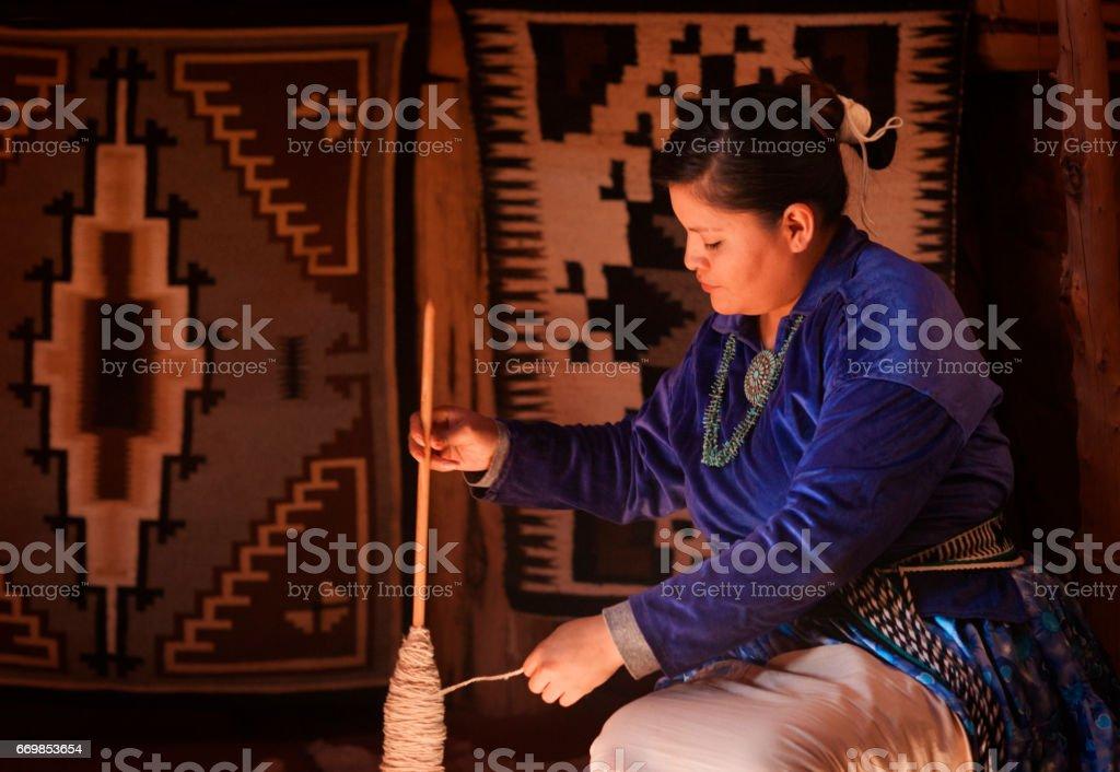 Navajo woman in hogan stock photo